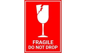 Līmējošas etiķetes ar brīdinājuma zīmēm Fragile do not drop un This side up